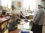 Воскресная школа. Подготовительная группа на занятии письма